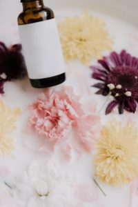 Essence Therapy jar and flowers