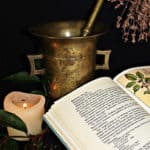 naturopathy book and mixing pot and candle